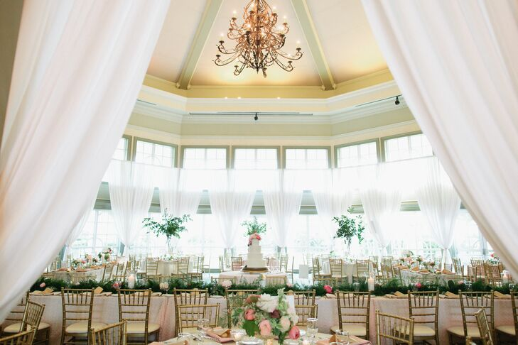 """Some of the words we used when describing our wedding vision to vendors were romantic, natural, lush, sentimental, elegant, playful and interesting,"" Christina says. ""Ashley, our wedding planner, was able to transform those select words into a stunning reception space."" The couple's reception was held in the ballroom at the botanical garden and was decked out in sheer draperies, lush greenery and floating candle displays."