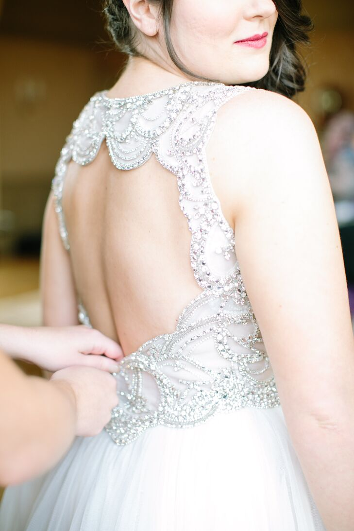"""The back of Tara's Jenny Packham wedding dress was all open with beautiful crystal beading. """"I didn't want to cover that - but I also wanted to wear my hair long,"""" she says. """"I ended up with long side swept curls fastened with a vintage inspired crystal hair clip."""""""