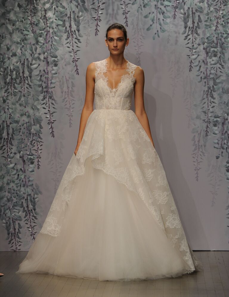 Monique Lhuillier wedding dress Fall 2016 Sorbet Chantilly lace sleeveless illusion V-neck ball gown with asymmetrical cascading overlay