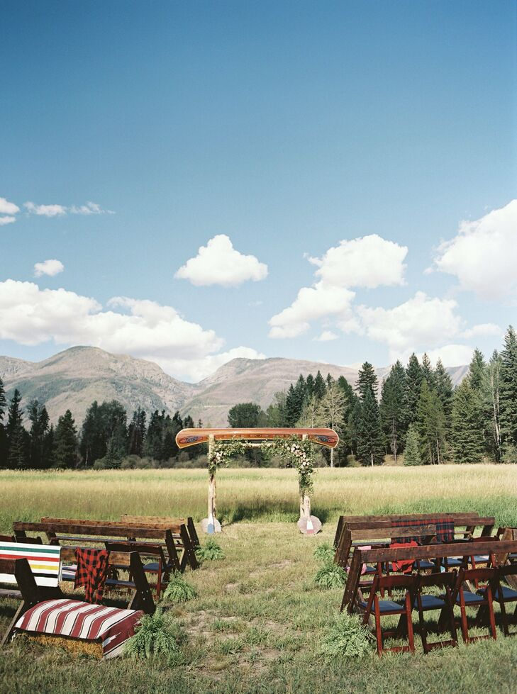 In keeping with the rustic theme of the wedding, the couple offered different seating options, including handmade benches (made by the bride's brother) and straw bales covered with Navajo blankets.