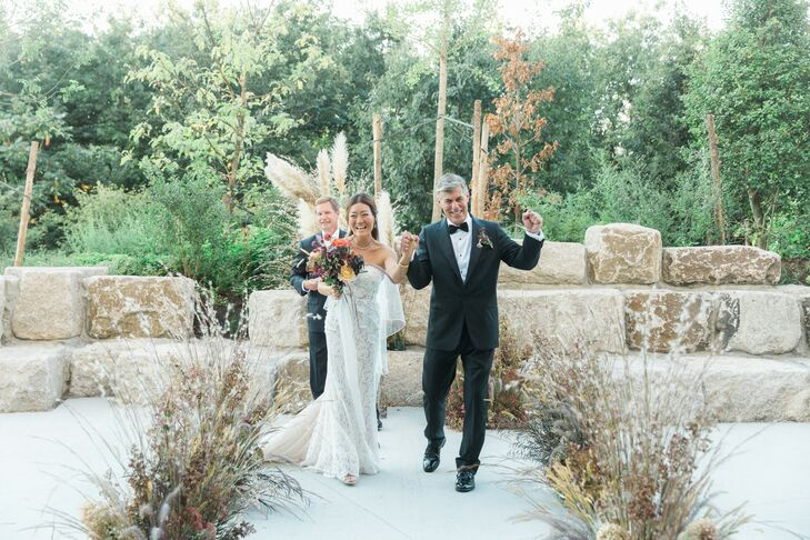 Elegant Couple Recessing Down Aisle of Dried Grass and Flower Arrangements