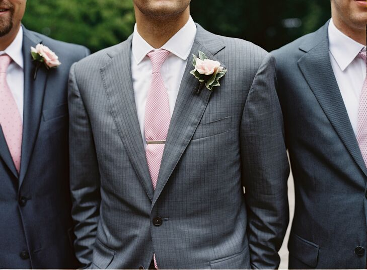 The groomsmen had small pink rose boutonnieres and wore gray suits accented with pink ties.