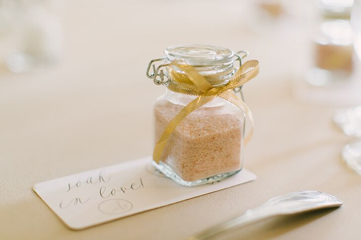 Guests took home wedding favors of Himalayan rock salt for either bathing or cooking purposes, which were presented in glass jars tied with yellow ribbon.