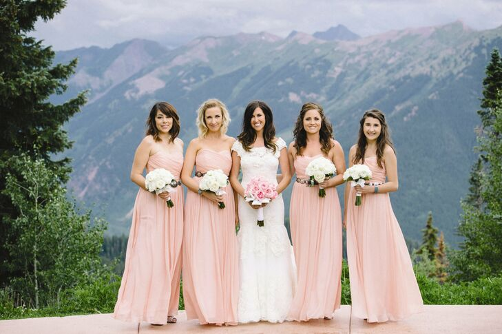 The bridesmaids wore flowing, floor-length pink gowns from J. Crew.