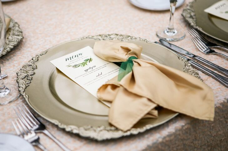 Gold napkins were tied with green ribbon, matching the menu card.
