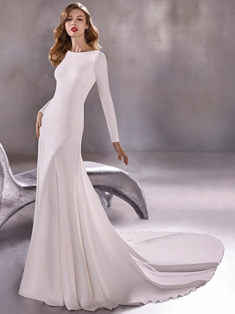 Atelier Provonias wedding dress lone sleeve trumpet gown with open back