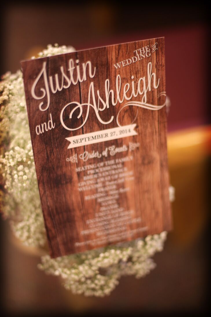 Ashleigh and Justin's program ceremonies kept with their rustic theme and had a wooden background printed on paper.