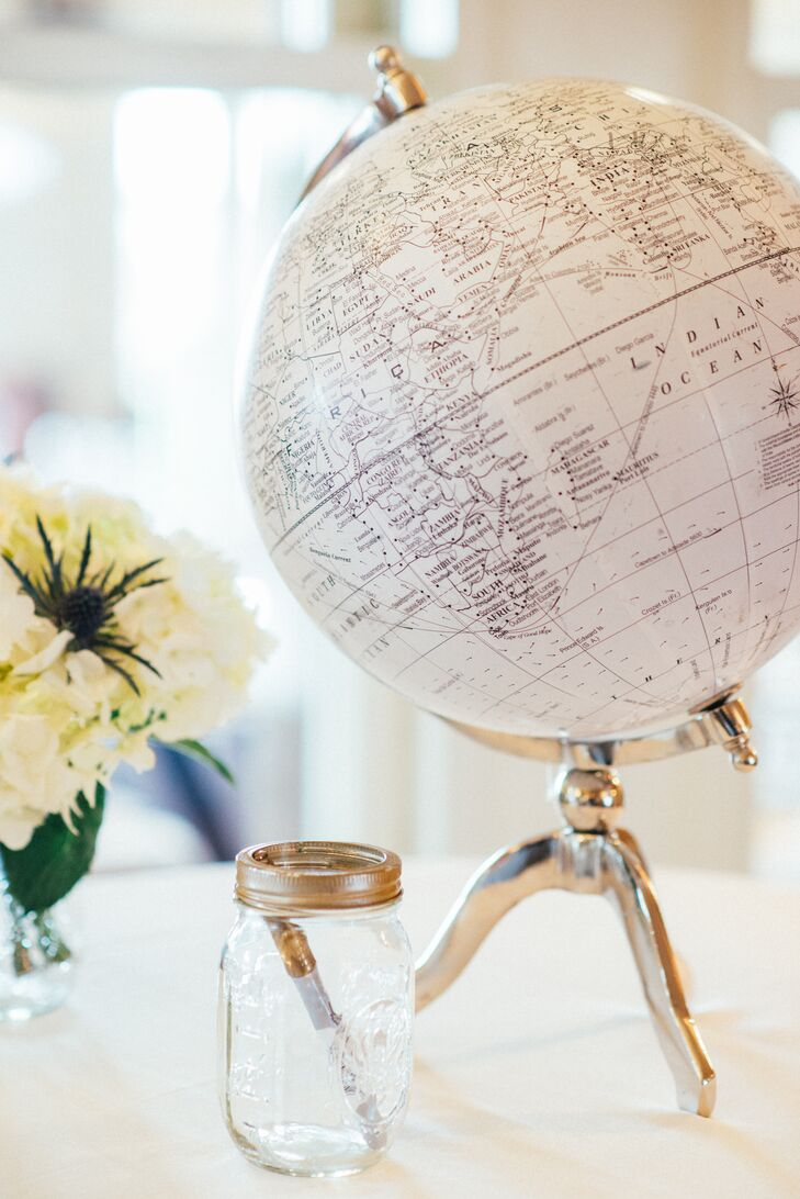 The guest book was another detail that spoke to Yecelin and Adrian's festive nautical theme. Instead of the classic book format, the couple had their families and friends write their well wishes and advice on a globe with gold ink, a play on traditional seafaring charts and maps.