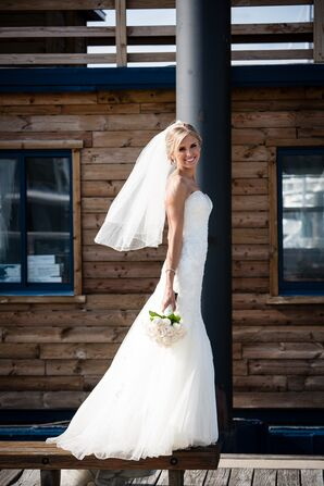 Bride in a Sophia Tolli Wedding Dress with a White Rose Bouquet