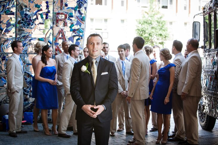 The groom wore a deep navy blue suit from Saks Fifth Avenue with a white rose boutonniere, while the  groomsmen wore khaki suits with light blue paisley ties.