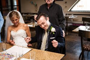 Bride and Groom Signing Traditional Jewish Wedding Contract