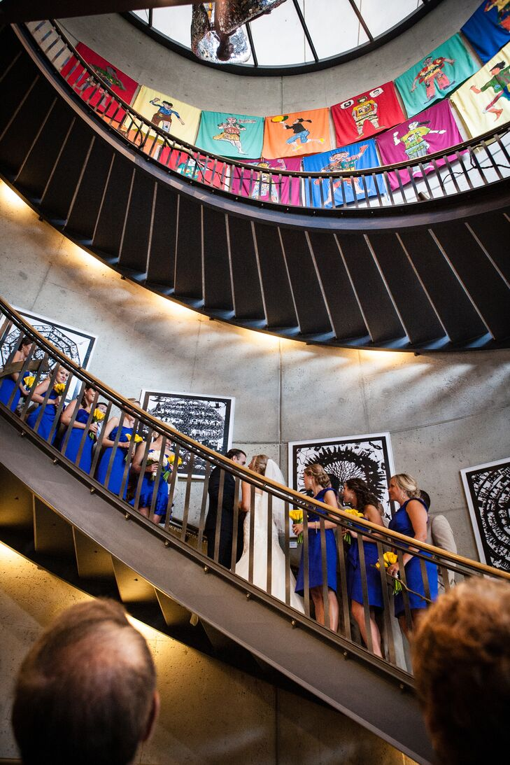 "The unconventional ceremony took place on the spiral staircase in the American Visionary Art Museum. ""We wanted a location that captured our vision: eclectic, modern and fun!"" says Emily."