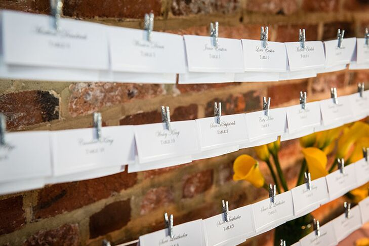 Guests found their escort cards hung on a line with clothespins.