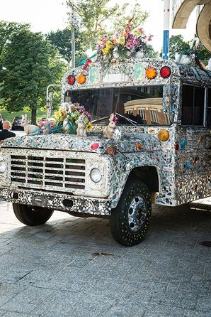 A Mosaic School Bus Decorated with Flowers at the Art Museum Venue