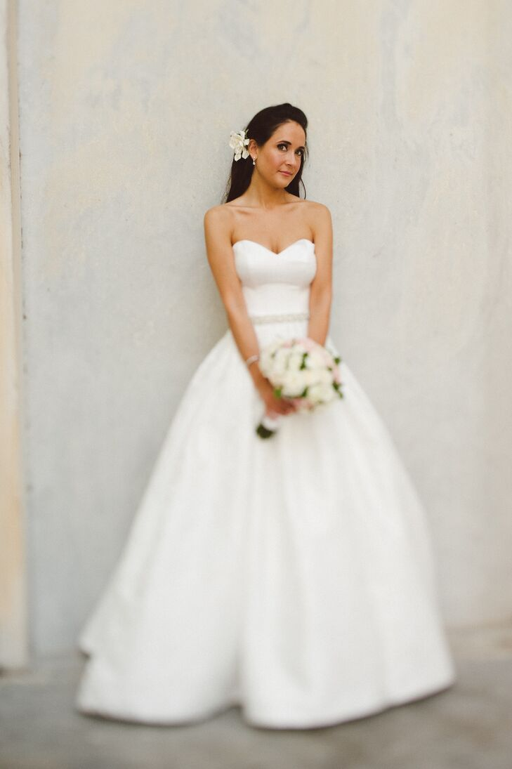 """The bride wore an A-line Martina Liana jacquard wedding dress. """"Jacquard fabric has this way of adding richness, texture and personality to the gown while maintaining a classic appeal,"""" says Rhea. The jacquard print featured gardenias."""