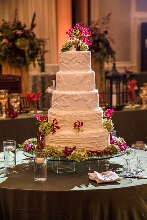 Five Tier White Wedding Cake Decorated with Flame Lilies
