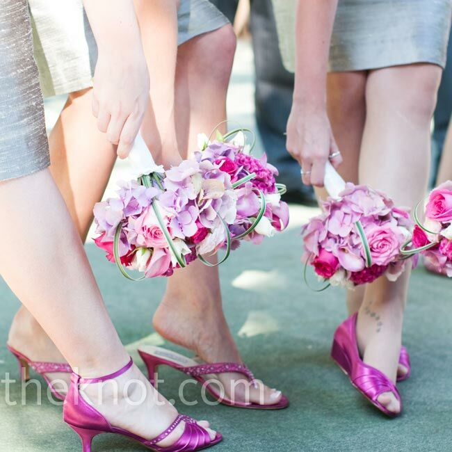 The six bridesmaids carried a similarly shaped bouquet with pink hydrangeas, hot and soft pink rose, lavender mini callas, white spray roses, zebra grasses, and locally grown cockscomb.