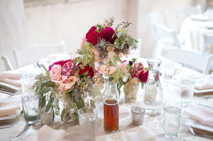 """The flowers for the winter wedding were in jewel tones of burgundy, pink and plum mixed with paler blush roses. """"We wanted eye-catching bright flowers to match the exuberance and joy we felt,"""" says the bride."""