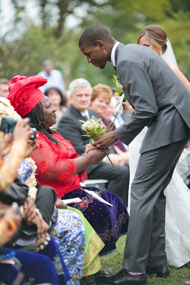"""During the ceremony, Jessica and Bassey wanted to acknowledge and thank their mothers for their love, commitment and selflessness in raising them. In gratitude, the couple delivered roses to each woman as a wedding tradition. """"This picture speaks a million words on the love between a mother and her son,"""" Jessica says."""