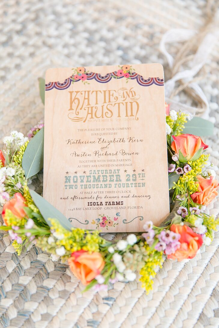 "Since Katie and Austin were inspired by a funky Americana-filled store, it was no surprise that their custom invitation had a patriotic banner along the front. It even incorporated their country decor with a cool western font along the date and neutral hues. ""Denise from Dogwood Blossom exceeded all my hopes and dreams for our funky, nontraditional invitations,"" Katie says. ""I love how personalized they were. I still pull it back out to look at it all the time."""