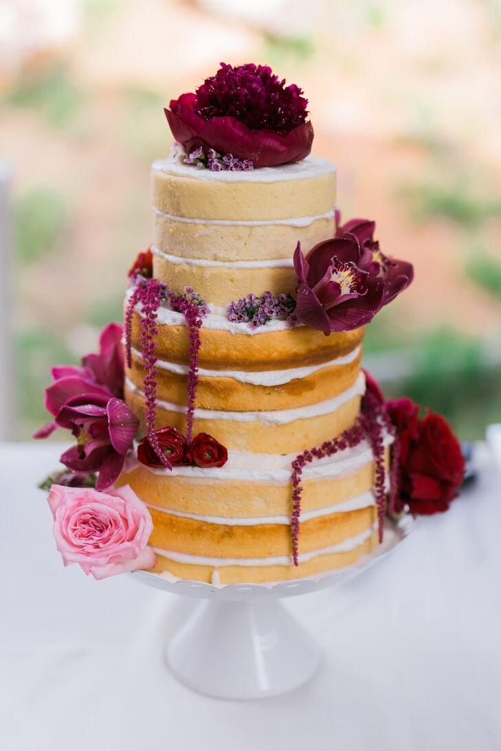 The couple enlisted the talents of their family members and friends to give the day a personalized feel. Lindsay's mother baked the wedding cake in her kitchen in Kansas, froze the layers and drove them to Colorado, where she thawed and assembled them with buttercream frosting. Lindsay and her mother then dressed up the naked cake with rich purple, pink and red blooms for dramatic effect.