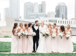 Bailey Groetsch and Kyle Welch's classic spring wedding paid tribute to their love of Nashville with a unique venue that showed off the city skyline,