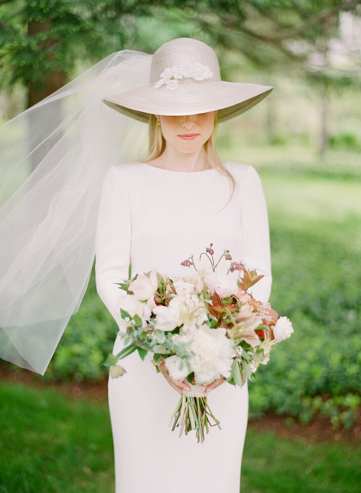 Drawing inspiration from her mother's 1970s bohemian wedding look, Sarah wore a custom Houghton gown and a similar veiled, broad-brim hat.