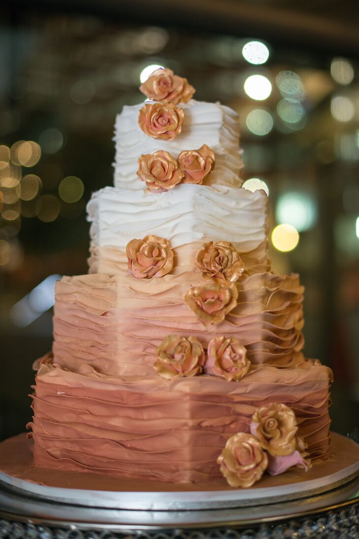 Marisa and Dan's traditional four-tier cake was decorated in a rose gold color, ombre style. Fondant flowers flowed asymmetrically down one side. The groom's cake, also fondant, was molded into the shape of the Jayhawk, the University of Kansas mascot.