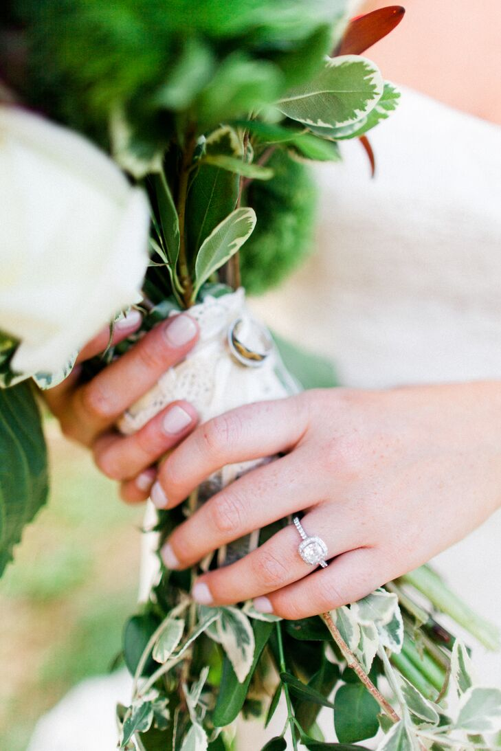 """""""My mom and sister made my bouquet on their ownrnand they surprised me by having my parents' wedding rings attached to the base for my something borrowed!"""" says Cory. """"That extra special little touch, along with knowing that it had been made with such care and love, made me so proud to carry it down the aisle!"""""""