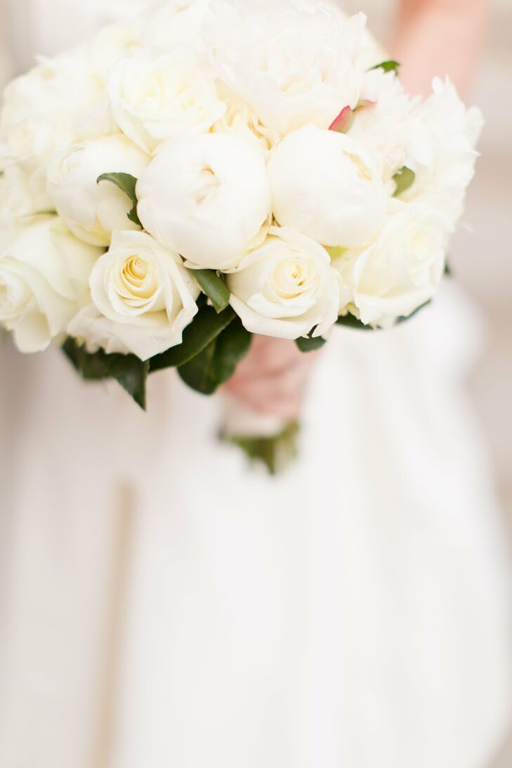 Lindsay carried a simple bouquet of white peonies and some roses. Peonies were not in season during the time of her winter wedding, so her florist imported them from New Zealand.