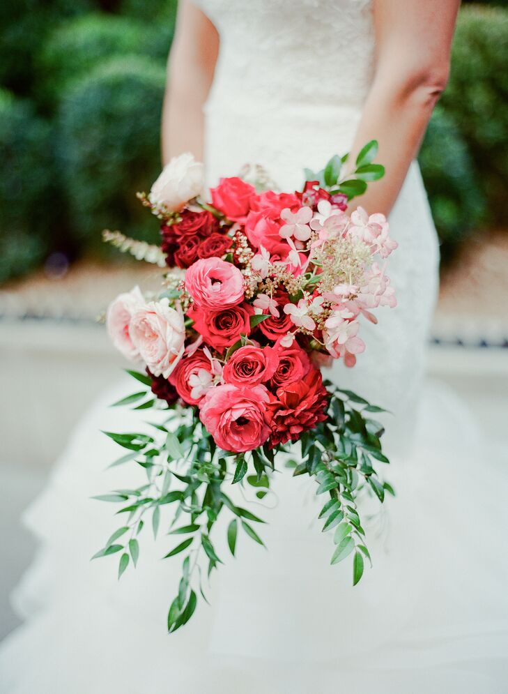 "Alexia and Jason left all the floral decisions up to the expertise of florist Kat Hyppolite of Kat Flower, who pulled together a striking selection of bold pink and red blooms, including garden roses, ranunculus and hydrangeas, for Alexia's walk down the aisle. ""Kat knew the general colors we were going for and gave us an idea of what we could expect to have in season around that time, but ultimately it was completely up to her and nature—we didn't want to force anything,"" Alexia says."