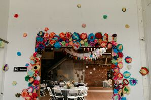 Reception Entry Covered in Bright, Colorful Paper Flowers