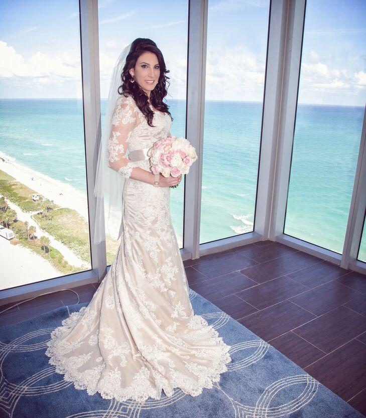 Shira wore a custom Martina Liana wedding dress with three-quarter length lace sleeves and a silver sash across the waist.