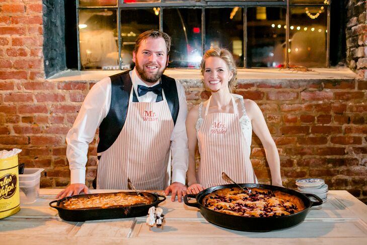 """Rather than serve wedding cake, Maggie and Doug had two giant cast-iron skillets filled with blackberry and apple cobbler. They served guests themselves, clad in aprons with """"Mr. Wilder"""" and """"Mrs. Wilder"""" printed on them. """"It was so special to just slow things down, serve our guests and share that extra moment with them,"""" Maggie says. """"Oh, and we didn't take those aprons off for a while. I think we danced three songs with them on."""""""