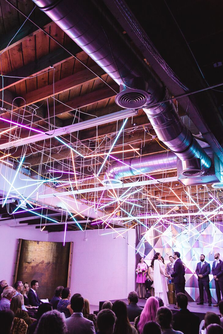 Couple Exchanges Vows in Neon-Lit Space
