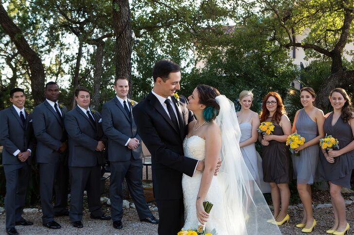 The groomsmen wore dark gray suits and David wore a black tuxedo.