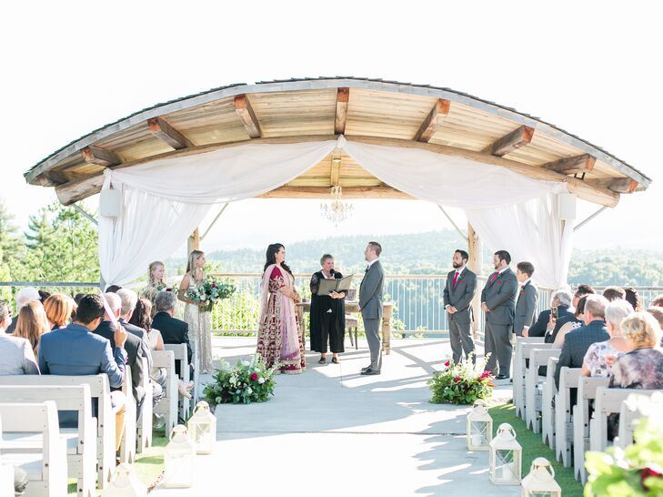 Rustic Wood Arch with White Fabric Draping