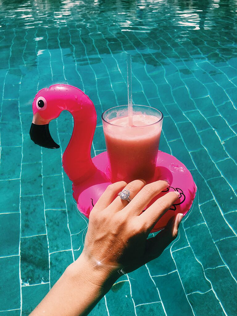 Engagement ring selfie idea with a cocktail pool float