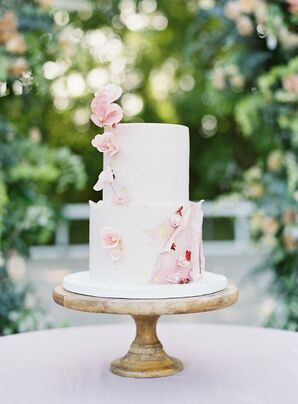 Tiered Fondant Wedding Cake with Pink Flowers and Wooden Stand