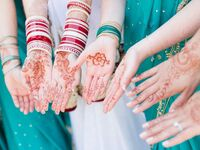 Bride and bridesmaids with mehndi designs