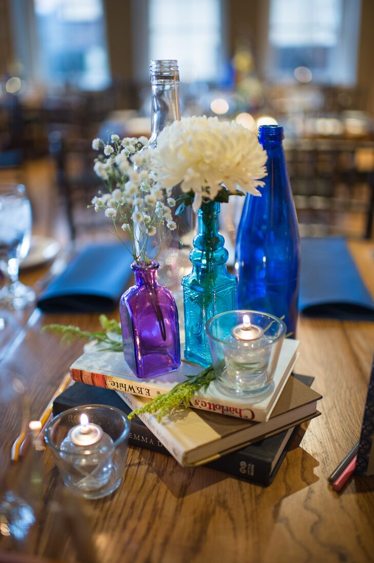 The centerpieces were an eclectic mix of bright blue and purple bottles, fresh blooms and books from Rachel's own personal collection.