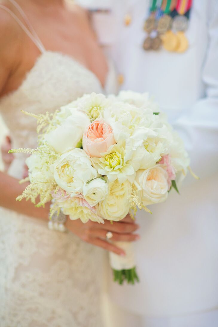 Molly chose a bouquet of white peonies, white dahlias, white and blush garden roses, white ranunculus and white astilbe. She wrapped it with lace from her wedding dress.