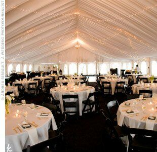 After the cocktail hour, guests returned to find the tent filled with tables set in white for dinner and a comforting aroma of food prepared on-site. As the sun faded, the couple lit strands of lights along the canopied ceiling that paired with glowing votives on the tables.