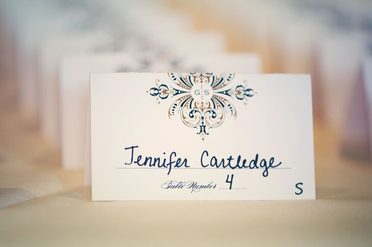 The escort cards featured an art deco motif with the couple's monogram.