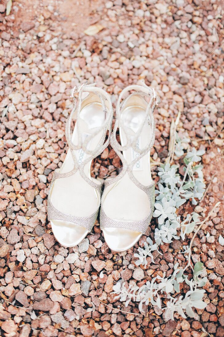 Strappy sandals add sophistication to the bride's ensemble.