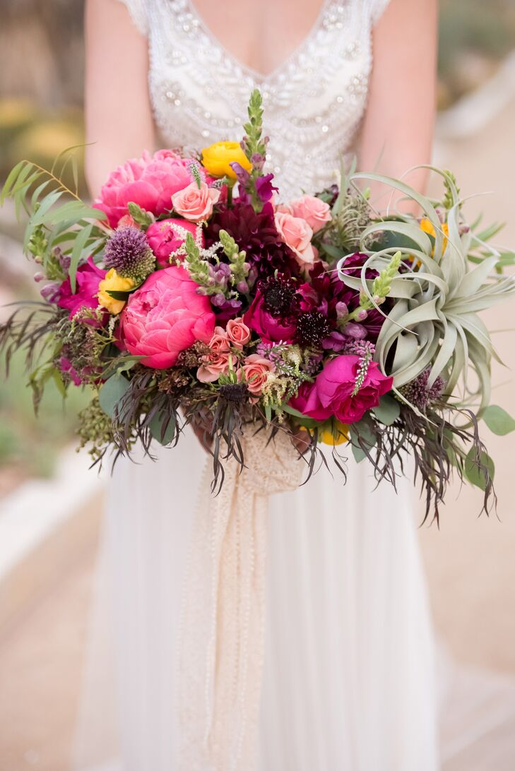 Florist Layers of Lovely crafted Jenna's vibrant bouquet, which was a wild, lively combination of air plants and colorful blossoms.