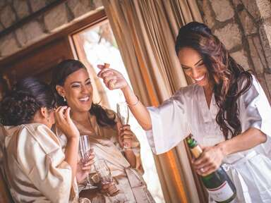 Bride toasting with bridesmaids