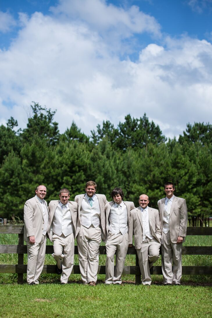 To fit with the summer farm wedding, Robert and his groomsmen wore tan suits from Jos. A. Bank.