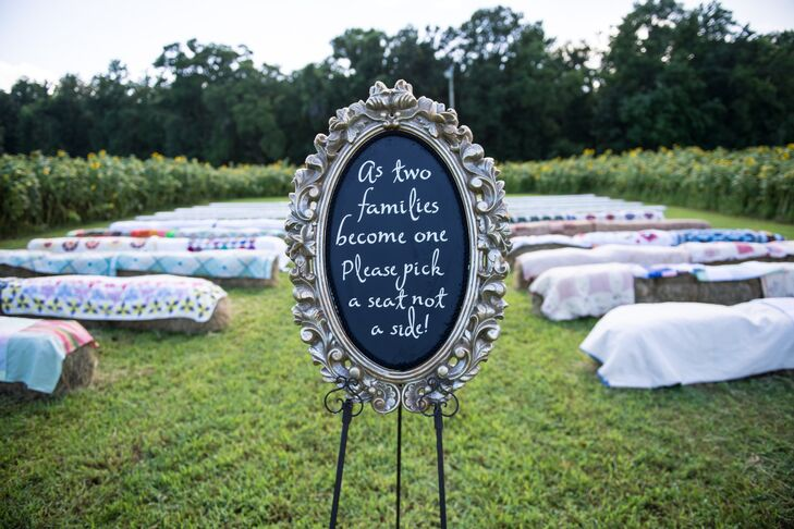 Despite rain before the ceremony, guests were able to sit on hay bails topped with homemade quilts during the outdoor ceremony.
