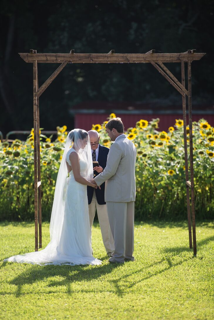 "The couple swapped vows at Robert's family farm in front of a ring of sunflowers planted for the occasion. "" The farm is where Robert asked me to be his girl friend and also where he asked me to be his wife,"" says Kasi."